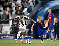 Football Soccer: UEFA Champions UEFA Champions League quarter final first leg Juventus-Barcellona, Juventus stadium, Turin, Italy, April 11, 2017. <br /> Juventus Dani Alves (l) in action with Barcellona Andr&eacute;s Iniesta (r) during the Uefa Champions League football match between Juventus and Barcelona at the Juventus stadium, on April 11 ,2017.<br /> UPDATE IMAGES PRESS/Isabella Bonotto