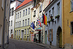 Europe, Estonia, Tallinn. Flags welcome tourists to quaint accommodations in the old town of Tallinn.