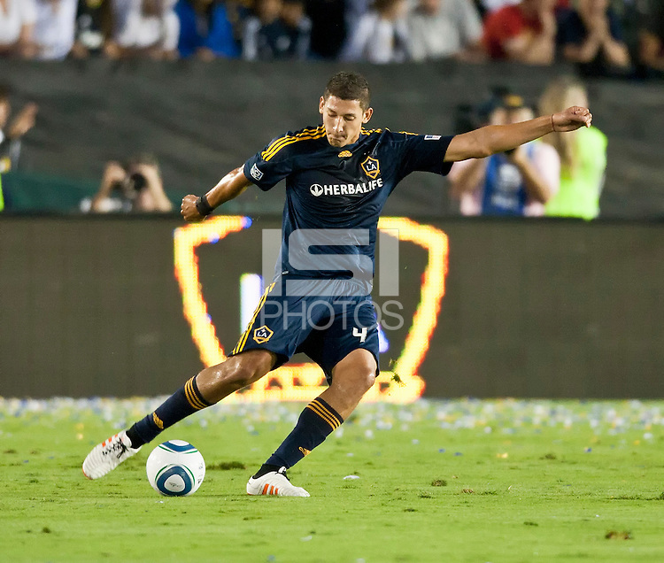 Galaxy defender Omar Gonzalez about to pass in the first half during a friendly game between LA Galaxy and Real Madrid at the Rose Bowl in Pasadena, CA, on August 7, 2010. LA Galaxy 2, Real Madrid 3.