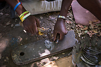 Haiti, Port-au-Prince. Noailles, the Village of Iron Craftsmen in Croix-des-Bouquets, an old sugar plantation, is now Haiti's iron center with 70 workshops, nearly 300 artists and impacts 7000 homes. The artists create iron work sculptures from oil drums.