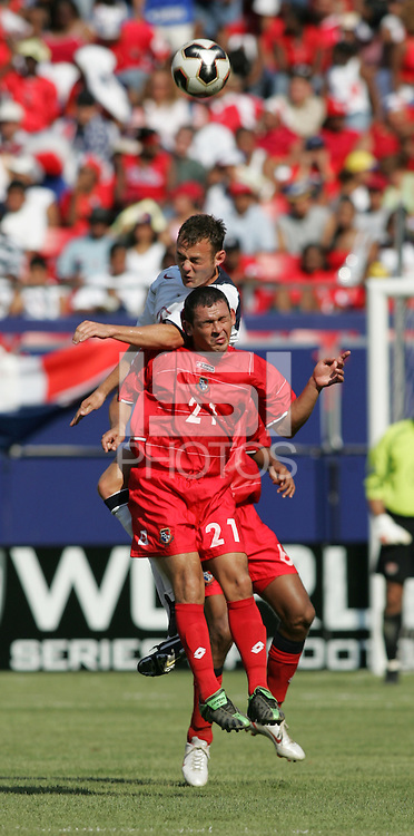 July 24, 2005: East Rutherford, NJ, USA:  USMNT midfielder Brad Davis (21) goes up for a header against Panama's Angel Luis Rodriguez (21) during the CONCACAF Gold Cup Finals at Giants Stadium.