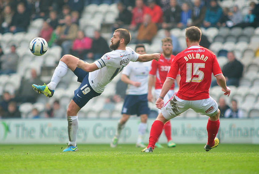 Preston North End's John Welsh lays the ball off under pressure from Crawley Town's Dannie Bulman <br /> <br /> Photo by Chris Vaughan/CameraSport<br /> <br /> Football - The Football League Sky Bet League One - Preston North End v Crawley Town - Saturday 29th March 2014 - Deepdale - Preston<br /> <br /> &copy; CameraSport - 43 Linden Ave. Countesthorpe. Leicester. England. LE8 5PG - Tel: +44 (0) 116 277 4147 - admin@camerasport.com - www.camerasport.com
