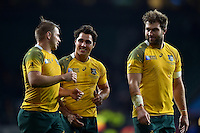 Drew Mitchell, Nick Phipps and Ben McCalman of Australia after the match. Rugby World Cup Semi Final between Argentina v Australia on October 25, 2015 at Twickenham Stadium in London, England. Photo by: Patrick Khachfe / Onside Images
