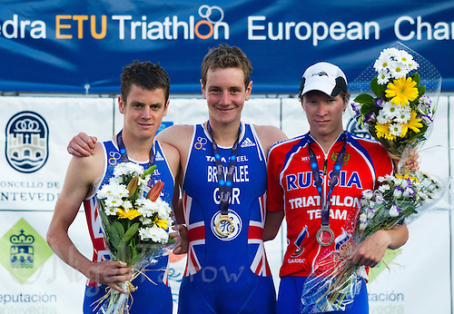 25 JUN 2011 - PONTEVEDRA, ESP - Winner Alistair Brownlee (GBR) (centre) poses for a picture flanked by silver medalist Jonathan Brownlee (GBR) (left) and bronze medalist Dmitry Polyansky (RUS) at the medal ceremony for the Elite Men's European Triathlon Championships in Pontevedra, Spain (PHOTO (C) NIGEL FARROW)