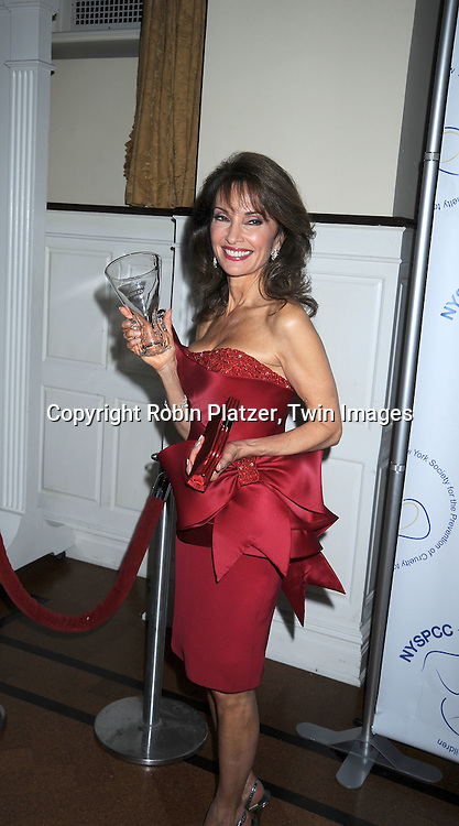 Susan Lucci in red Marchesa dress and Gucci purse