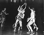 18 MAR 1953:  Kansas center B.H. Horn (25) out rebounds Indiana guard Charley Kraak (13) during the NCAA Men's Basketball National Championship held in Kansas City, MO. Indiana defeated Kansas 69-68 for the title. Photo Copyright Rich Clarkson