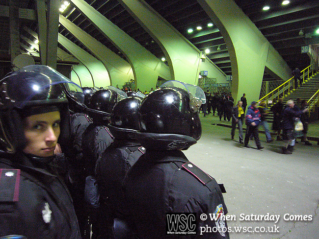 Ukraine 2 Scotland 2, 11/10/2006. Olympic Stadium, Euro 2008 Qualifying. Ukrainian police dressed in riot gear observe fans of Scotland and Ukraine as they arrive for the match between the two countries. Ukraine defeated Scotland 2-0 after a goal-less first half in this Euro 2008 group qualifying match played at the Olympic Stadium in Kyiv (Kiev). This was the first competitive international match between the countries. Photo by Colin McPherson.