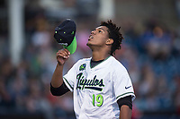 Hillsboro Hops starting pitcher Luis Frias (19) walks off the field between innings of a Northwest League game against the Salem-Keizer Volcanoes at Ron Tonkin Field on September 1, 2018 in Hillsboro, Oregon. The Salem-Keizer Volcanoes defeated the Hillsboro Hops by a score of 3-1. (Zachary Lucy/Four Seam Images)