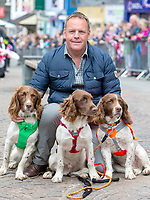 Kerry Irving with his three dogs Max, Paddy, and Harry during a visit to the market town of Keswick in Cumbria where they join a celebration to recognise the contribution of individuals and local organisations in supporting communities and families across Cumbria. They meet volunteers including those from the local mountain rescue service, community first responders, young people trained as mental health first aiders and other organisations that have benefitted from grants from the Cumbria Community Foundation. Photo Credit: ALPR/AdMedia
