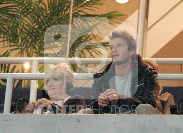 Real Madrid's David Beckham watches the match VIP box high up in the stands during Spain's King's Cup match at Santiago Bernabeu stadium in Madrid, Thursday January 19, 2007. (ALTERPHOTOS/Alvaro Hernandez).