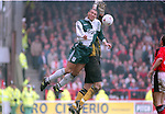 Stan Collymore of Liverpool tussles with Mark Crossley of Nottingham Forest - Premier League - Nottingham Forest v Liverpool - City Ground - Nottingham - England - 23rd March 1996 - Picture Simon Bellis/Sportimage
