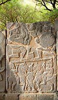 Pictures & images of the South Gate Hittite sculpture stele depicting Hittite Gods. 8th century BC. Karatepe Aslantas Open-Air Museum (Karatepe-Aslantaş Açık Hava Müzesi), Osmaniye Province, Turkey.
