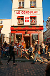 Le Consulat restaurant on a busy pedestrian corner in Montmartre