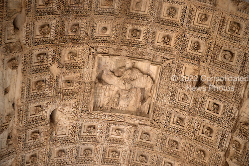 The soffit of the axial archway of the Arch of Titus, located on the Via Sacra, just to the south-east of the Roman Forum in Rome, Italy on Wednesday, October 23, 2013.  It is deeply coffered with a relief of the apotheosis of Titus at the center. It was constructed c. 82 AD by the Roman Emperor Domitian shortly after the death of his older brother Titus to commemorate Titus' victories, including the Siege of Jerusalem in 70 AD. The Arch is said to have provided the general model for many of the triumphal arches erected since the 16th century&mdash;perhaps most famously it is the inspiration for the 1806 Arc de Triomphe in Paris, France, completed in 1836.<br /> Credit: Ron Sachs / CNP