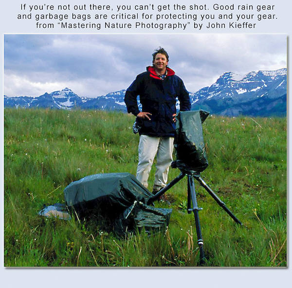 Being a good photographers is just a third of it, you also had to survive and not get lost. This was before GPS and cell phones. It was easy to be out of touch with civilization for 4 to 5 days.  John and view camera, staying dry in the San Juan Mountains in southwest Colorado.