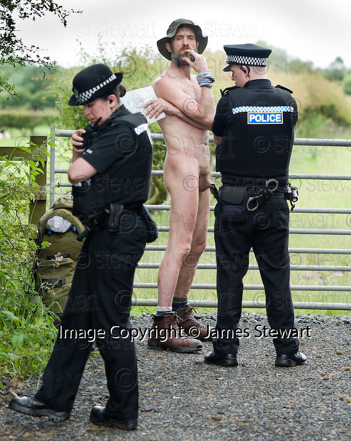 Naked rambler Stephen Gough talks to police officers from Fife Constabulary prior to being arrested outside the village of Townhill, north of Dunfermline