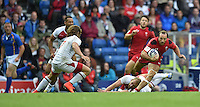 Wales's William Harries evades the tackle of England's Mark Bright<br /> <br /> Wales Vs England - men's classification 5th - 6th place match<br /> <br /> Photographer Chris Vaughan/CameraSport<br /> <br /> 20th Commonwealth Games - Day 4 - Sunday 27th July 2014 - Rugby Sevens - Ibrox Stadium - Glasgow - UK<br /> <br /> © CameraSport - 43 Linden Ave. Countesthorpe. Leicester. England. LE8 5PG - Tel: +44 (0) 116 277 4147 - admin@camerasport.com - www.camerasport.com