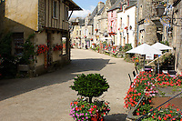 Rochefort-en-Terre in Brittany is officially one of France's hundred most beautiful villages. It's famous for the displays of flowers which decorate the streets and houses every summer.
