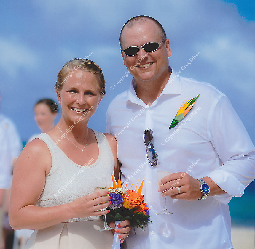 The matron of honor, Kayla Markovich, and best man, Jared's brother Matt Newgent, smile during the wedding ceremony on Friday