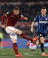 Calcio, Serie A: Roma vs Inter. Roma, stadio Olimpico, 19 marzo 2016.<br /> Roma's Edin Dzeko kicks the ball during the Italian Serie A football match between Roma and FC Inter at Rome's Olympic stadium, 19 March 2016. The game ended 1-1.<br /> UPDATE IMAGES PRESS/Isabella Bonotto
