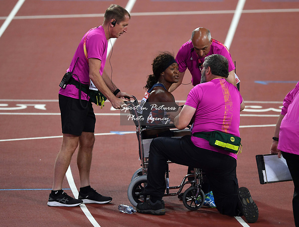 Antoinette Nana Djimou Ida (FRA) is put in a wheelchair at the end of her 800m in the womens heptathlon. IAAF world athletics championships. London Olympic stadium. Queen Elizabeth Olympic park. Stratford. London. UK. 06/08/2017. ~ MANDATORY CREDIT Garry Bowden/SIPPA - NO UNAUTHORISED USE - +44 7837 394578