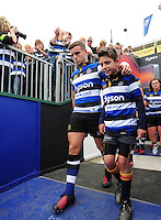 George Ford of Bath Rugby, mascot in hand, leads his team out onto the field. Aviva Premiership match, between Bath Rugby and Newcastle Falcons on September 10, 2016 at the Recreation Ground in Bath, England. Photo by: Patrick Khachfe / Onside Images