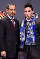 MLS commissioner Don Garber poses with Danny O'Rourke (Indiana U.) after being picked by San Jose Earthquakes in the first round of the MLS SuperDraft held at the Baltimore Convention Center, Baltimore, MD, on Friday, January14, 2005..