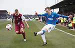 Robbie Crawford crosses in past Michael Travis