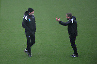 (L-R) Graham Potter Manager of Swansea City speaks with Billy Reid, assistant manager for Swansea City during the Swansea City Training at The Fairwood Training Ground, Swansea, Wales, UK. Friday 15 March 2019