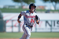 Salt River Rafters shortstop Carter Kieboom (24), of the Washington Nationals organization, runs to third base during an Arizona Fall League game against the Surprise Saguaros on October 9, 2018 at Surprise Stadium in Surprise, Arizona. The Rafters defeated the Saguaros 10-8. (Zachary Lucy/Four Seam Images)