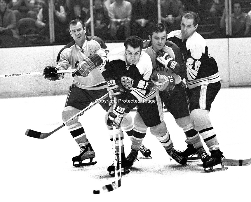 Seals Gerry Ehman and Ernie Hicke batle Bruins Don Marcotte, and Dallas Smith.(photo/Ron Riesterer)