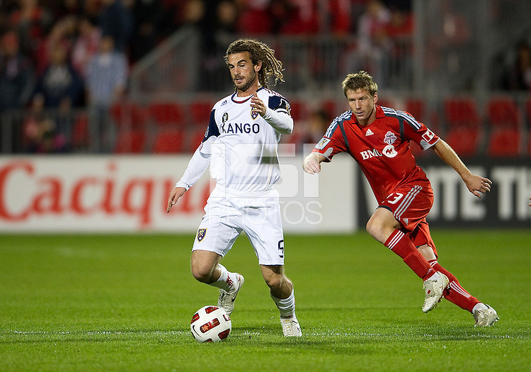 28 September 2010: Real Salt Lake midfielder Kyle Beckerman #5 and Toronto FC midfielder Jacob Petersen #23 in action during a CONCACAF Champions League game between Real Salt Lake and Toronto FC at BMO Field in Toronto...