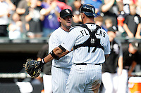 Chicago White Sox catcher Tyler Flowers #17 and pitcher Will Ohman #77 congratulate each other after a game against the Kansas City Royals at U.S. Cellular Field on August 14, 2011 in Chicago, Illinois.  Chicago defeated Kansas City 6-2.  (Mike Janes/Four Seam Images)