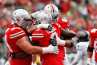 Ohio State celebrates after Ohio State Buckeyes wide receiver Michael Thomas (3) ran in the first touchdown for the Buckeyes against Kent State in the first quarter, at Ohio Stadium in Columbus, Saturday, September 13, 2014. (Dispatch Photo by Jenna Watson)
