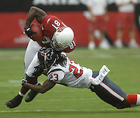 Aug 18, 2007; Glendale, AZ, USA; Arizona Cardinals wide receiver Anquan Boldin (81) is tackled by Houston Texans cornerback Dunta Robinson (23) in the first quarter at University of Phoenix Stadium. Mandatory Credit: Mark J. Rebilas-US PRESSWIRE Copyright © 2007 Mark J. Rebilas