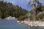 """Dixieland"" Fannette Island in the middle of Emerald Bay with the M.S. Dixie touring the bay during a beautiful Summer day in Lake Tahoe."
