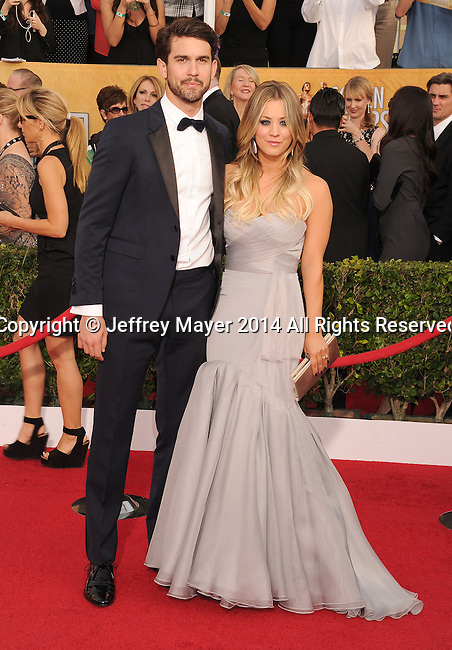 LOS ANGELES, CA- JANUARY 18: Actress Kaley Cuoco (R) and tennis player Ryan Sweeting arrive at the 20th Annual Screen Actors Guild Awards at The Shrine Auditorium on January 18, 2014 in Los Angeles, California.