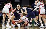 SIOUX FALLS, SD - MARCH 8: Monica Arens (on floor) grabs a loose ball against Oral Roberts at the 2020 Summit League Basketball Championship in Sioux Falls, SD. (Photo by Richard Carlson/Inertia)