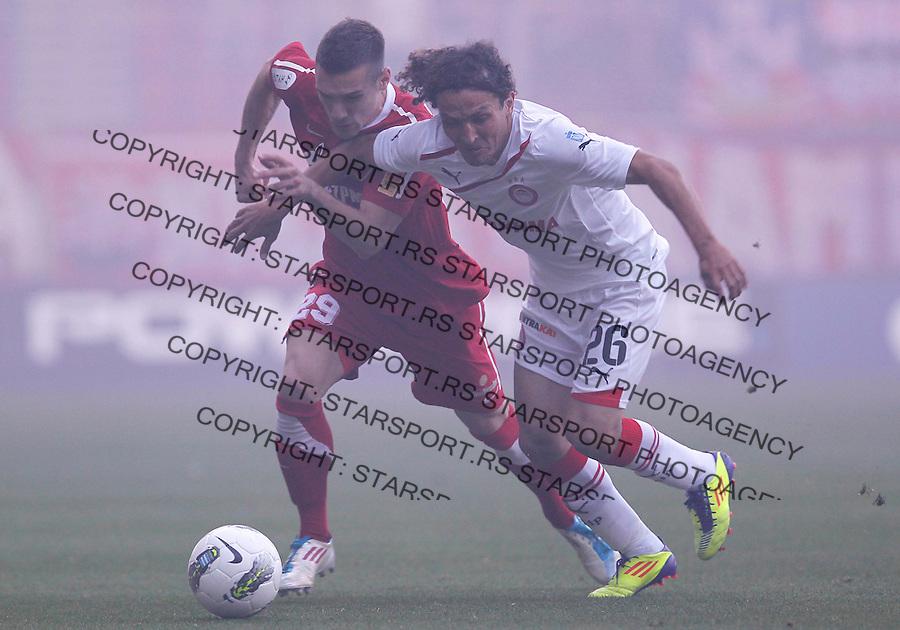 Fudbal.Olympiacos Vs. Crvena Zvezda.Marko Vesovic, left and Vicente Alfredo Monje.Athens, 09.05.2012..foto: Srdjan Stevanovic/Starsportphoto ©