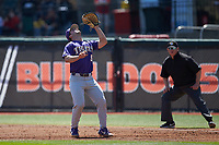 LSU Tigers first baseman Drew Bianco (5) settles under a pop fly as first base umpire Darrell Arnold looks on during the game against the Georgia Bulldogs at Foley Field on March 23, 2019 in Athens, Georgia. The Bulldogs defeated the Tigers 2-0. (Brian Westerholt/Four Seam Images)