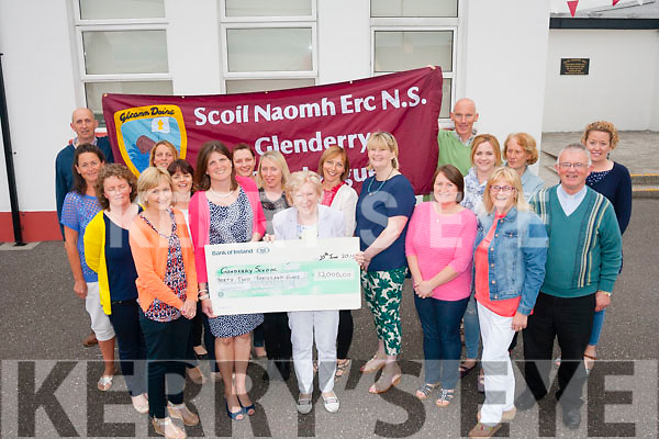 Raisers for fun<br /> --------------------<br /> On Tuesday evening last Br&iacute;d Cotter (front centre) chairperson of Sco&iacute;l Naomh Erc NS,Ballyheigue accepts a Cq for &euro;32000 from Geraldine Harty,treasurer of the fundraising committee along with many of the parents of the school who helped raise the money for an all weather pitch at the school.