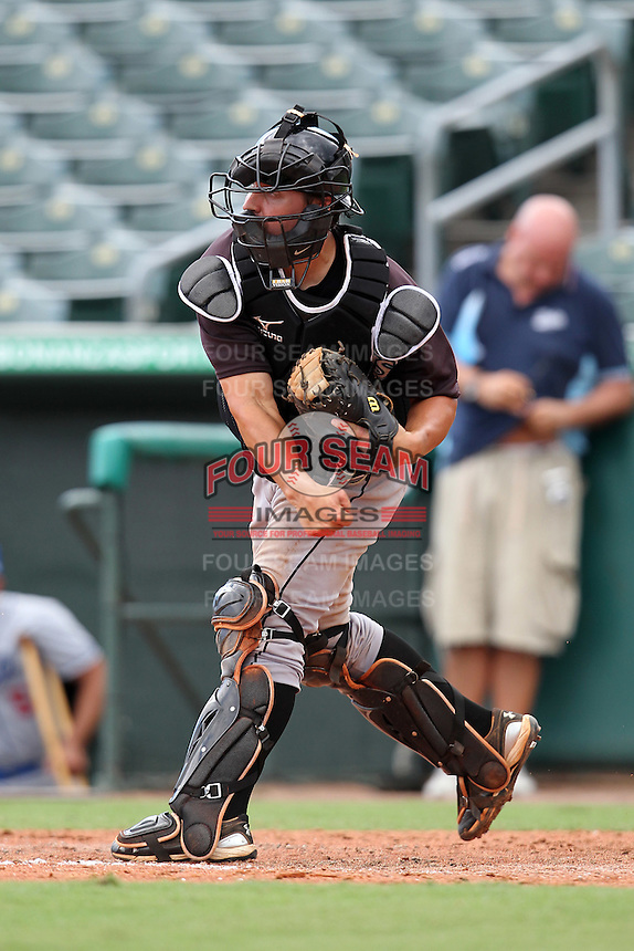 catcher Tony Caldwell #14 of the Florida Marlins instructional League team during a game against the Italian National Team at the Roger Dean Stadium in Jupiter, Florida;  September 27, 2011.  Italy is training in Florida for the Baseball World Cup.  (Mike Janes/Four Seam Images)