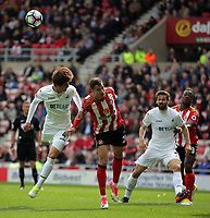 (L-R) Ki Sung-Yueng of Swansea City battles for a header against Javier Manquillo of Sunderland during the Premier League match between Sunderland and Swansea City at the Stadium of Light, Sunderland, England, UK. Saturday 13 May 2017