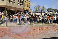 Visitors are watching to end of explosion of tens of meters long firecrackers in the city.....End of year 2010 celebrations on the streets of Paramaribo. Suriname is one of biggest consumer in South America that using firecrackers, fireworks ( also locally known as pagara ) for celebrations, especially for end of every years and also beginning of every new Chinese Years.
