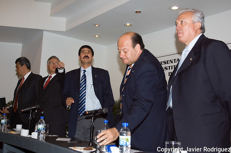 Mexican senators Raymundo Cardenas (R-L), Cesar Raul Ojeda, Javier Corral and Manuel Bartlett arrive at the Senate venue to address a press conference with media on Telecommunications Law approved by the Mexican Congress, May 4, 2006. Forty-six Senators handed over an action against Telecommunications Law, best known as Ley Televisa  before the Supreme Court in order to declare it unconstitutional as the  46 Senators declared that the law directly benefits the two biggest broadcasting groups, Televisa and TV Azteca, since they are granted free digital spectrum.Photo by Javier Rodriguez