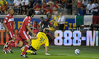 AC Milan midfielder Clarence Seedorf (10) dribbles past Chicago Fire goalkeeper Andrew Dykstra (40) to score the game's only goal.  AC Milan defeated the Chicago Fire 1-0 at Toyota Park in Bridgeview, IL on May 30, 2010.