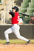 Michael Johnson #5 of the Kannapolis Intimidators follows through on his swing against the Hickory Crawdads at CMC-Northeast Stadium on April 8, 2012 in Kannapolis, North Carolina.  The Intimidators defeated the Crawdads 12-11.  (Brian Westerholt/Four Seam Images)