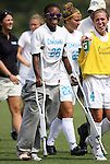 20 September 2009: North Carolina's Nikki Washington (on crutches) with teammate Meghan Klingenberg (4). The University of North Carolina Tar Heels played the Auburn University Tigers to a 0-0 tie after overtime at Koskinen Stadium in Durham, North Carolina in an NCAA Division I Women's college soccer game.