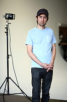 A Photo Assistant is shown standing in for the model so the photograher can test the lighting.
