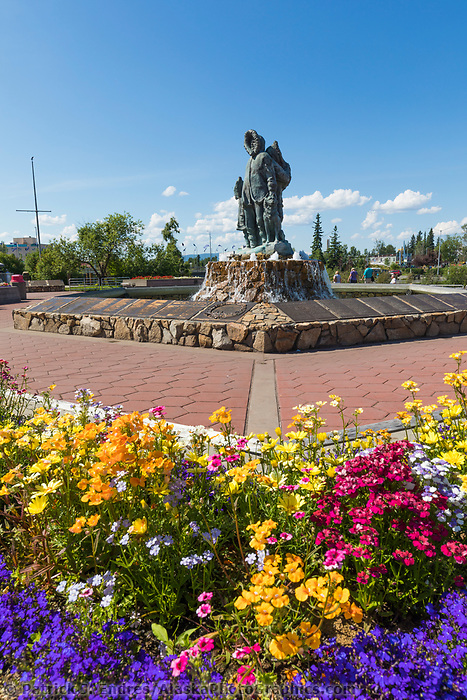 First Family Statue and summer flowers in the Golden Heart Plaza in downtown Fairbanks, Alaska